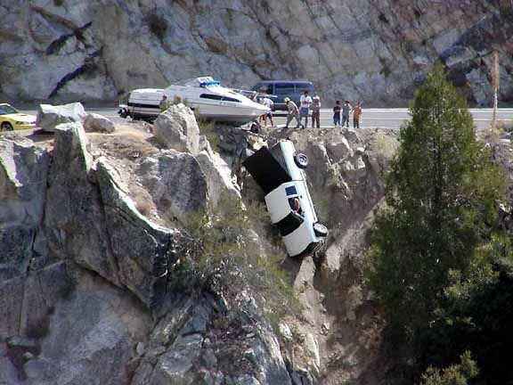 Truck Hanging Over Cliff